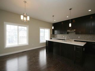 Photo 2: 102 SHERWOOD Mount NW in Calgary: Sherwood Calgary Residential Detached Single Family for sale : MLS®# C3653275