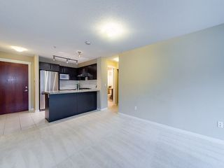 "Photo 2: 102 9199 TOMICKI Avenue in Richmond: West Cambie Condo for sale in ""MERIDIAN GATE"" : MLS®# R2006928"