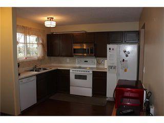 Photo 2: 75 WHITMAN Crescent NE in Calgary: Whitehorn House for sale : MLS®# C4038203
