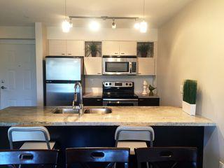"Photo 4: 203 7445 120 Street in Delta: Scottsdale Condo for sale in ""TREND"" (N. Delta)  : MLS®# R2094769"