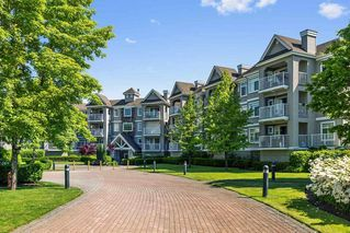 Photo 1: 215 20896 57 Avenue in Langley: Langley City Condo for sale : MLS®# R2168965