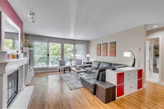 """Photo 1: 201 2733 ATLIN Place in Coquitlam: Coquitlam East Condo for sale in """"Atlin Court"""" : MLS®# R2295428"""