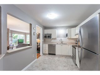 Photo 10: 104 7161 121 Street in Surrey: West Newton Condo for sale : MLS®# R2308592
