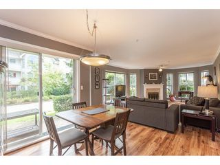 Photo 3: 104 7161 121 Street in Surrey: West Newton Condo for sale : MLS®# R2308592