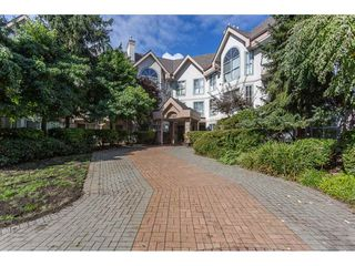Photo 1: 104 7161 121 Street in Surrey: West Newton Condo for sale : MLS®# R2308592