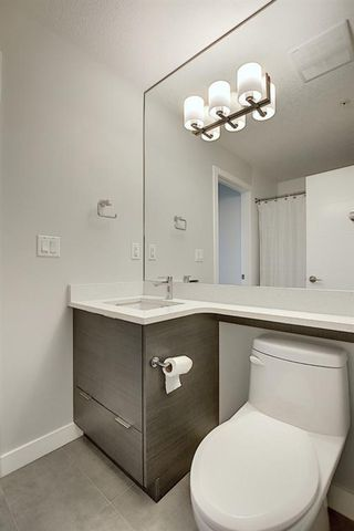 Photo 24: 1316 95 BURMA STAR Road SW in Calgary: Currie Barracks Apartment for sale : MLS®# A1036267
