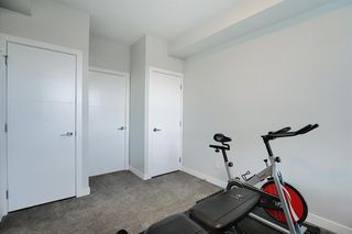 Photo 22: 1316 95 BURMA STAR Road SW in Calgary: Currie Barracks Apartment for sale : MLS®# A1036267