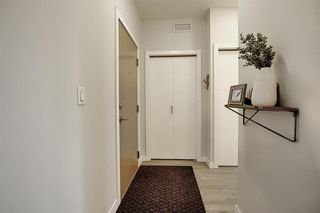 Photo 25: 1316 95 BURMA STAR Road SW in Calgary: Currie Barracks Apartment for sale : MLS®# A1036267