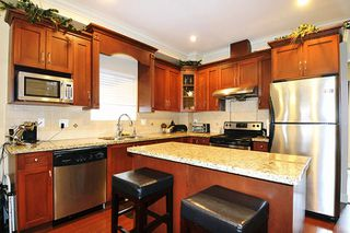 """Photo 2: 24279 101A Avenue in Maple Ridge: Albion House for sale in """"CASTLE BROOK"""" : MLS®# R2041174"""
