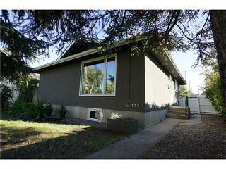 Photo 2: 2411 54 Avenue SW in Calgary: North Glenmore Park House for sale : MLS®# C4081948