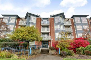 "Photo 1: 109 20245 53 Avenue in Langley: Langley City Condo for sale in ""Metro 1"" : MLS®# R2119043"