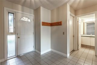 Photo 2: #34 5810 PATINA DR SW in Calgary: Patterson House for sale : MLS®# C4138541
