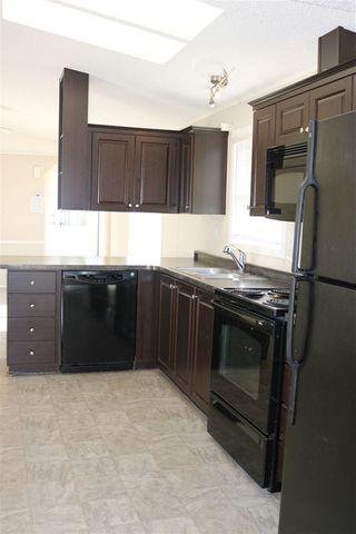 Photo 6: 432 Oak Wood Crescent Avenue in Edmonton: Zone 42 Mobile for sale : MLS®# E4141131