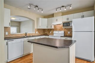 Photo 9: 40 EVERSYDE Park SW in Calgary: Evergreen Row/Townhouse for sale : MLS®# C4283416