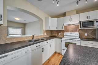 Photo 11: 40 EVERSYDE Park SW in Calgary: Evergreen Row/Townhouse for sale : MLS®# C4283416