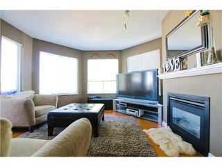 "Main Photo: 306 5759 GLOVER Road in Langley: Langley City Condo for sale in ""College Court"" : MLS®# F1430779"