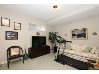 Photo 7: 155 CRAWFORD Drive: Cochrane House for sale : MLS®# C4092224