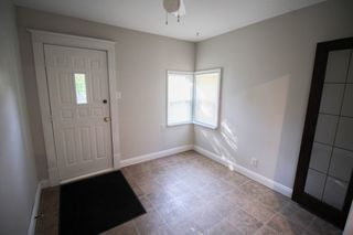 Photo 4: 2.5 Storey home with 3 bedrooms in Corydon close to the village & night life!