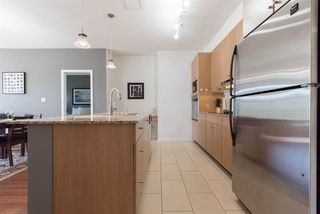 """Photo 6: 207 15322 101 Avenue in Surrey: Guildford Condo for sale in """"Ascada"""" (North Surrey)  : MLS®# R2206995"""