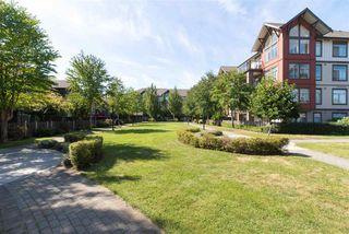 """Photo 2: 207 15322 101 Avenue in Surrey: Guildford Condo for sale in """"Ascada"""" (North Surrey)  : MLS®# R2206995"""