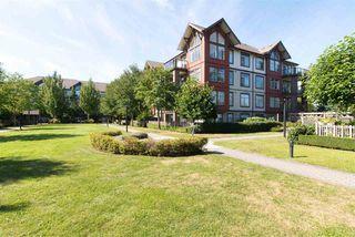 """Photo 1: 207 15322 101 Avenue in Surrey: Guildford Condo for sale in """"Ascada"""" (North Surrey)  : MLS®# R2206995"""