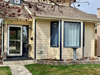 Photo 2: 1126 MILLCREST Rise SW in Calgary: Millrise Detached for sale : MLS®# C4243967