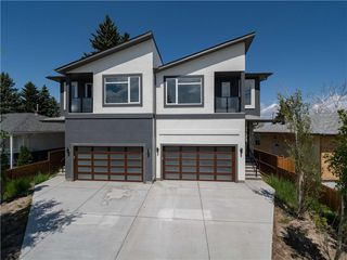 Main Photo: 124 42 Avenue NW in Calgary: Highland Park Semi Detached for sale : MLS®# A1060567