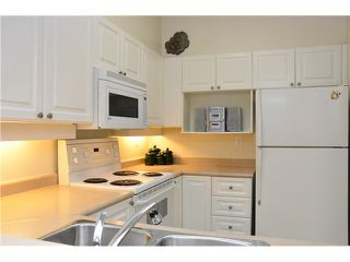Photo 4: 106 3070 GUILDFORD Way in Coquitlam: North Coquitlam Condo for sale : MLS®# V990045