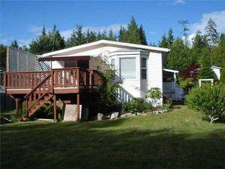 "Photo 1: 25 1123 FLUME Road: Roberts Creek Manufactured Home for sale in ""IKE-LON"" (Sunshine Coast)  : MLS®# V1057294"