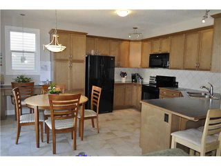 Photo 4: 2020 WINDSONG Drive SW: Airdrie Residential Detached Single Family for sale : MLS®# C3615799