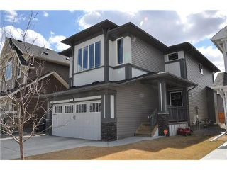 Photo 1: 109 HEARTLAND Way: Cochrane House for sale : MLS®# C4044449
