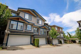 "Photo 1: 26 14462 61A Avenue in Surrey: Sullivan Station Townhouse for sale in ""RAVINA"" : MLS®# R2078323"