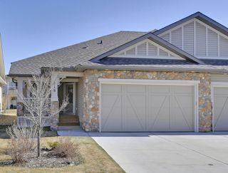 Photo 1: 215 Sunset Square in Cochrane: Duplex for sale : MLS®# C4007845