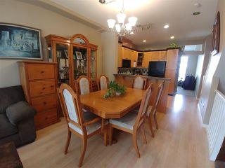 "Photo 3: 38 7250 144 Street in Surrey: East Newton Townhouse for sale in ""Chimney Ridge"" : MLS®# R2339008"