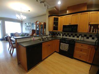 "Photo 2: 38 7250 144 Street in Surrey: East Newton Townhouse for sale in ""Chimney Ridge"" : MLS®# R2339008"