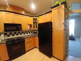 "Photo 6: 38 7250 144 Street in Surrey: East Newton Townhouse for sale in ""Chimney Ridge"" : MLS®# R2339008"