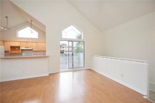 Photo 3: 305 1997 Sirocco Drive SW in Calgary: Signal Hill Row/Townhouse for sale : MLS®# C4303715