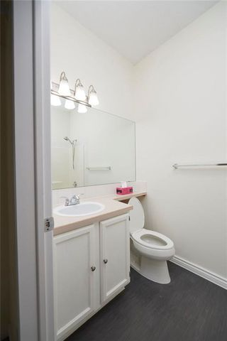 Photo 11: 305 1997 Sirocco Drive SW in Calgary: Signal Hill Row/Townhouse for sale : MLS®# C4303715
