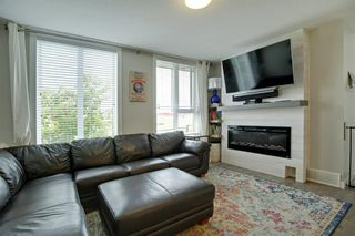 Photo 5: 302 DRAKE LANDING Wynd: Okotoks Row/Townhouse for sale : MLS®# A1018886