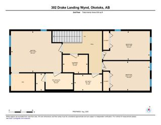 Photo 33: 302 DRAKE LANDING Wynd: Okotoks Row/Townhouse for sale : MLS®# A1018886