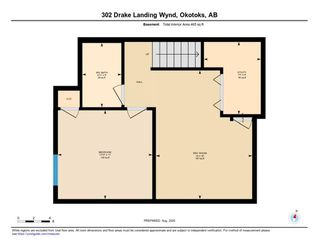 Photo 34: 302 DRAKE LANDING Wynd: Okotoks Row/Townhouse for sale : MLS®# A1018886