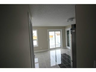 Photo 5: 35 CARMEL Close NE in CALGARY: Monterey Park Residential Detached Single Family for sale (Calgary)  : MLS®# C3597213