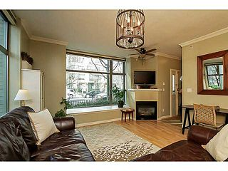 "Photo 2: 104 928 RICHARDS Street in Vancouver: Yaletown Townhouse for sale in ""THE SAVOY"" (Vancouver West)  : MLS®# V1050267"