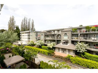 "Photo 1: 306 2373 ATKINS Avenue in Port Coquitlam: Central Pt Coquitlam Condo for sale in ""CARMANDY"" : MLS®# V1069079"