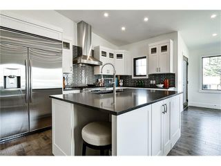 Photo 11: 1103 40 Street SW in Calgary: Rosscarrock House for sale : MLS®# C4059738