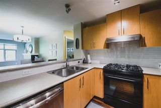 "Photo 6: 302 400 KLAHANIE Drive in Port Moody: Port Moody Centre Condo for sale in ""TIDES"" : MLS®# R2170542"