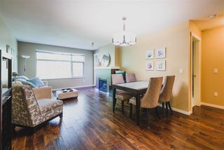 "Photo 2: 302 400 KLAHANIE Drive in Port Moody: Port Moody Centre Condo for sale in ""TIDES"" : MLS®# R2170542"