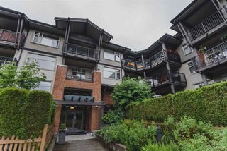 "Photo 1: 302 400 KLAHANIE Drive in Port Moody: Port Moody Centre Condo for sale in ""TIDES"" : MLS®# R2170542"