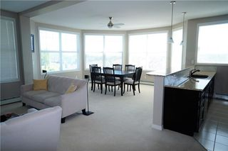 Photo 4: #301 1 Crystal Green LN: Okotoks Condo for sale : MLS®# C4125513