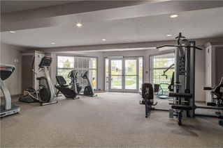 Photo 34: #301 1 Crystal Green LN: Okotoks Condo for sale : MLS®# C4125513